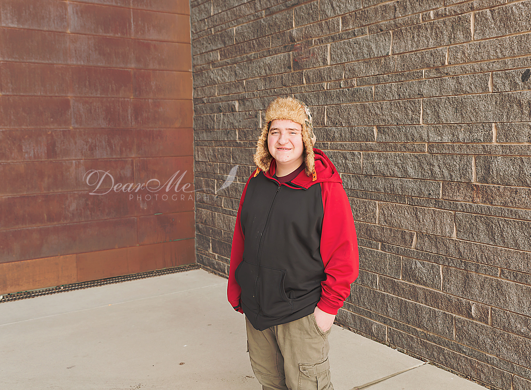 dear me photographer bismarck teen photographer teenage boy wearing black and red sweatshirt