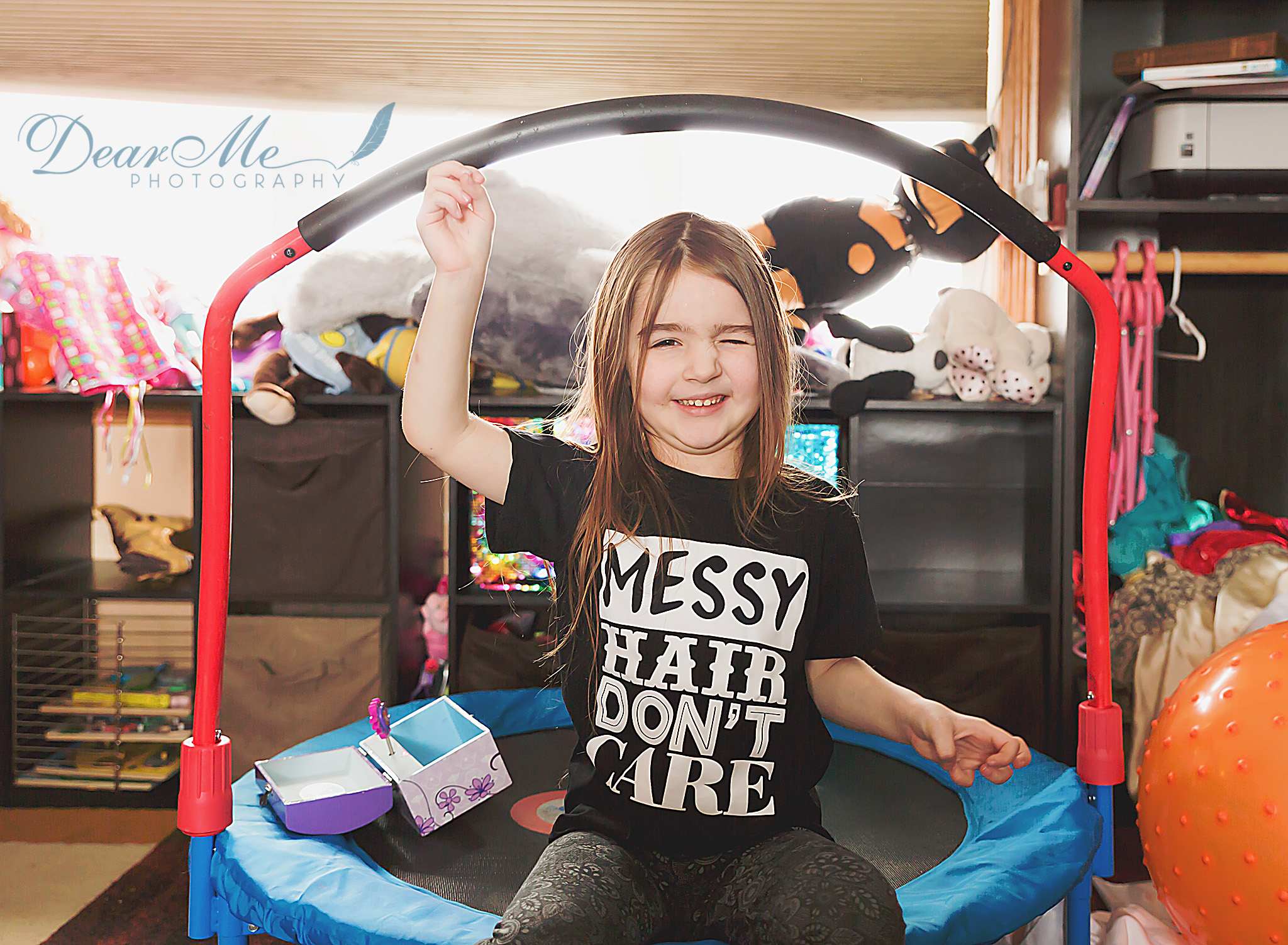 dear me photography mandan child photographer girl sitting on trampoline
