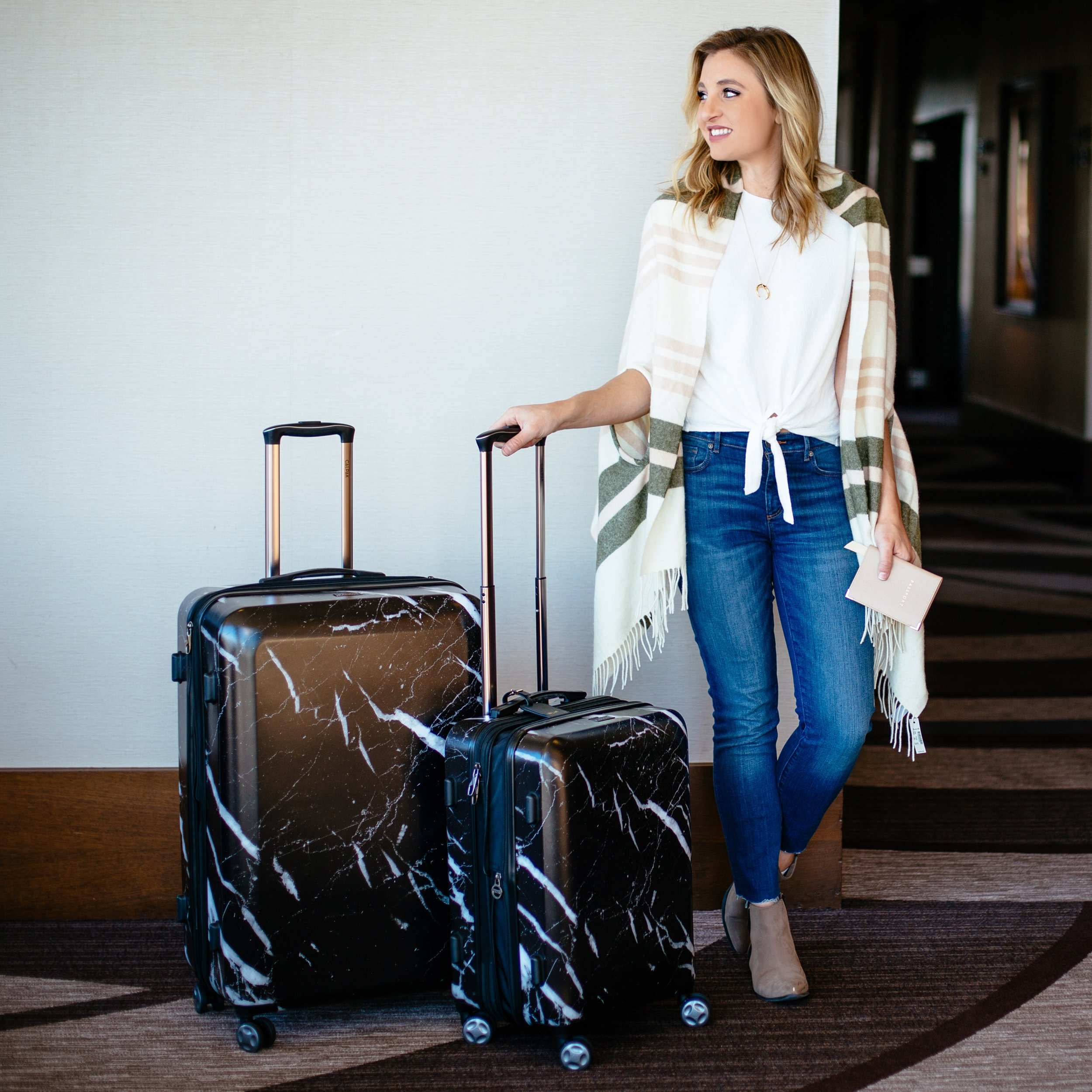 LUGGAGE: CALPAK ,  PONCHO: MADEWELL ,  TIE-TOP: MADEWELL ,  NECKLACE: GORJANA