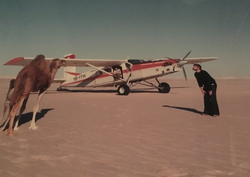 A young Urs encounters a camel in the Libyan desert while flying for the Italian oil firm Agip