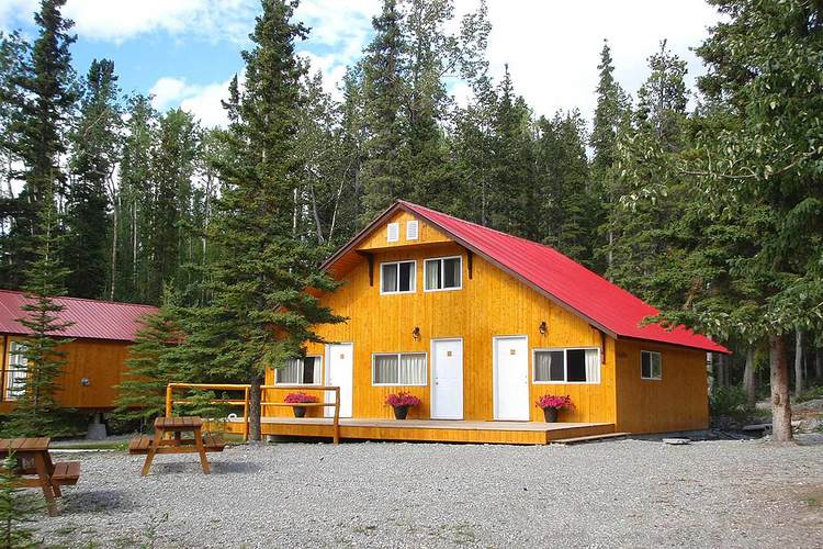 Lakeshore Grant's Cabin   This cabin has three spacious units with a great view out onto Muncho Lake. Rooms feature a cozy breakfast nook, shared patio, lakeside barbecue pit, WIFI internet, standard TV, modern bathroom with tub & shower, and a hairdryer.   Room configurations:  Unit A - 1 Queen, Unit B - 1 Queen 1 Single, Unit C - 2 Queen
