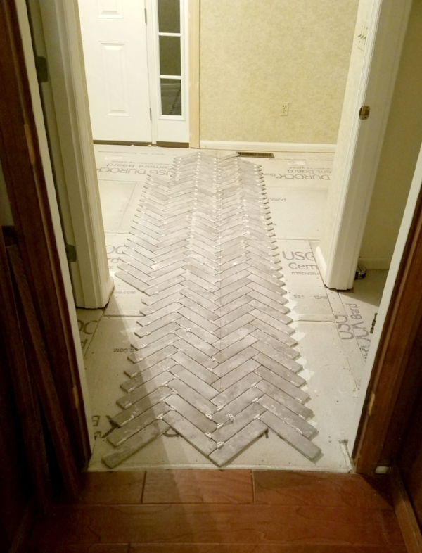first rows of herringbone brick tile