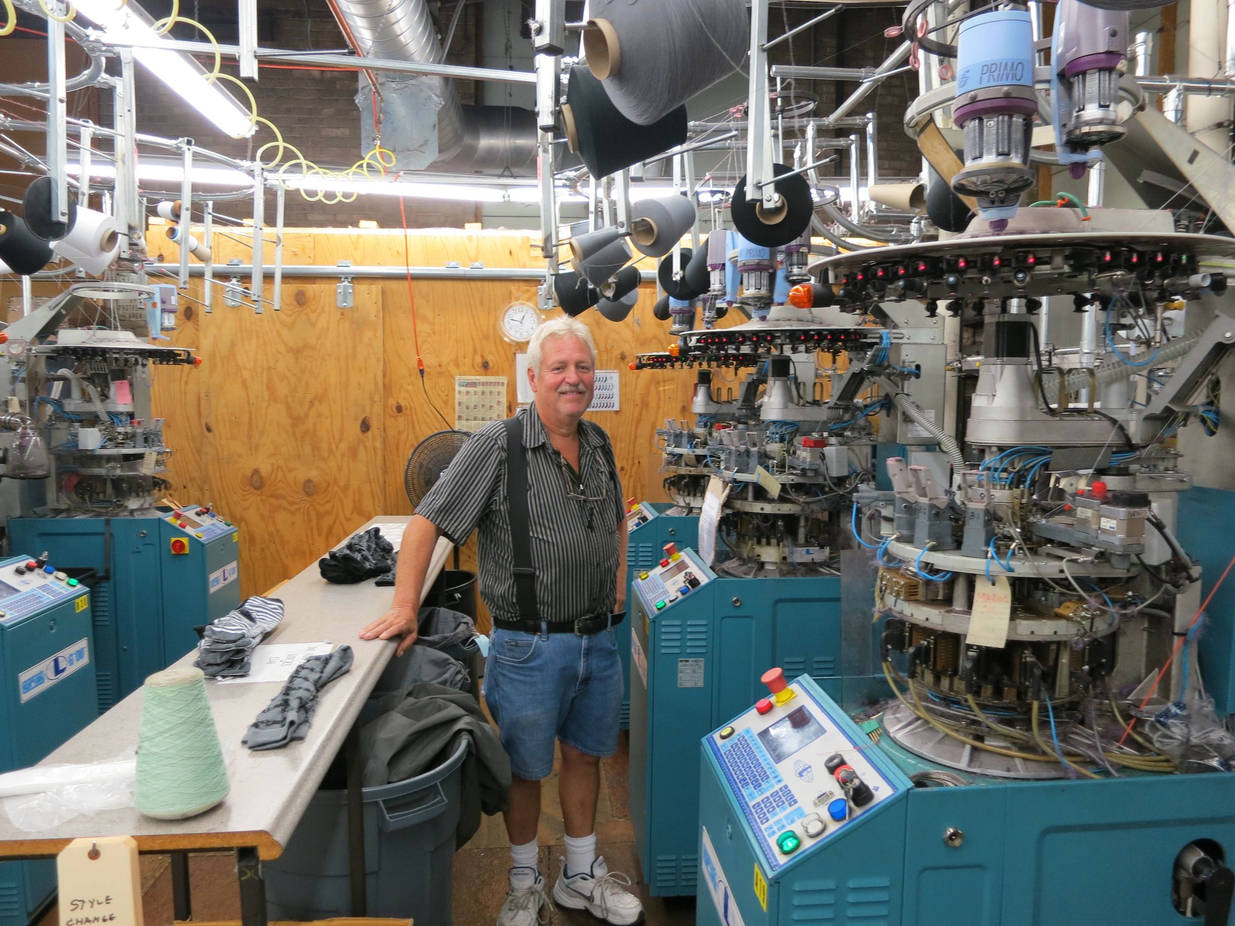 Terry, sock genius, in front of the knitting machines used for THIS NIGHT's socks