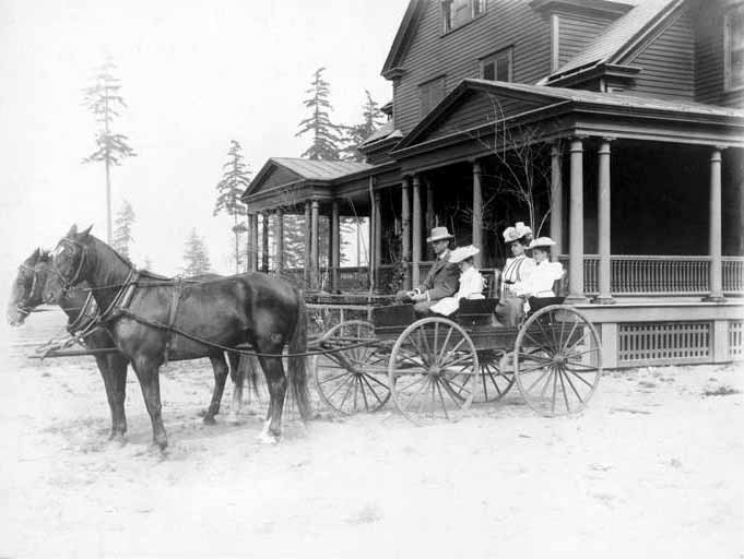 Ambrose Kiehl and family in horse and buggy in front of newly completed First-Lieutenant's House