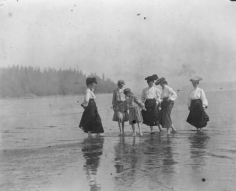 Laura, Miriam and friends cooling their feet at South Beach below Fort Lawton, Washington, 1905.