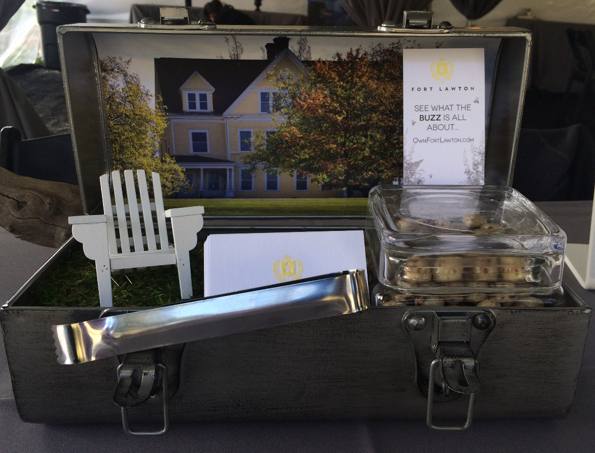 "PICTURED ABOVE: The ""Broker Box"" – a preview of the creative counter gift box that will be delivered to local real estate offices inviting broker participation to an upcoming Broker's Open House on September 29, 2015."