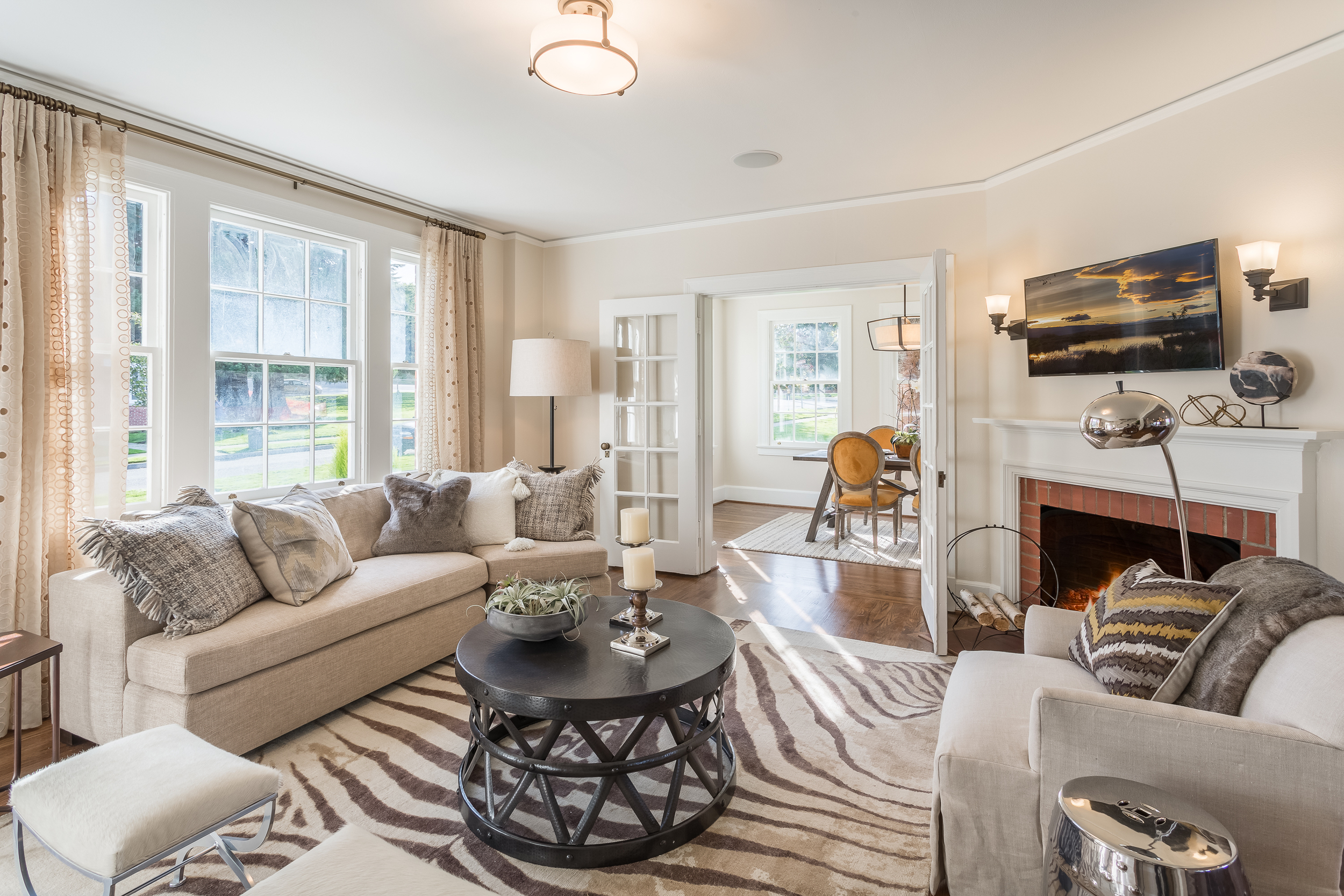ABOVE AND BELOW : These move-in-ready heirloom homes at Fort Lawton (shown above) have three-bedrooms and nostalgic yet modern open floor plans. Even better, Discovery Park is your backyard.