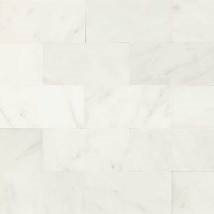 Natural marble tile accents at bathrooms