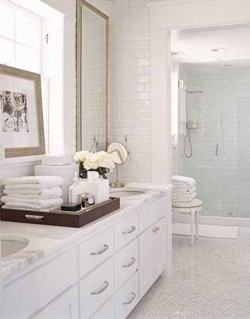 Polished natural marble slab countertops over custom cabinetry at bathrooms