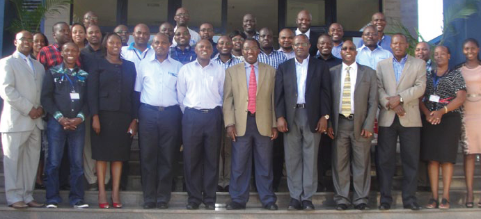 Above: The Family Bank Managers in cohort1 take a group photo with Daystar University Vice-chancellor, Dr. Timothy Wachira (c), ILPD Director Dr. Abraham Waithima (front row far right) and other University officials