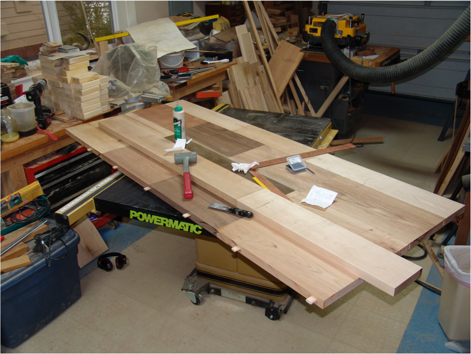 Continued construction of the top. Note the exposed tenons, hidden but important members in the table top.