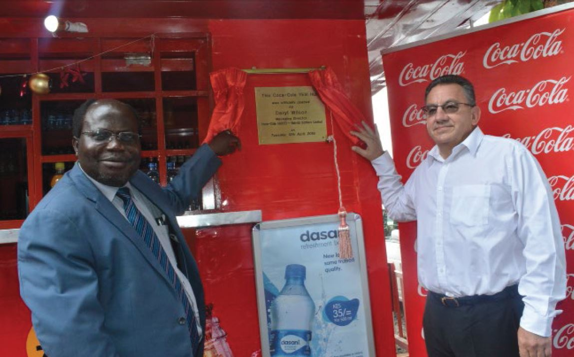 DVC Academic Affairs Professor James Kombo (right) and Managing Director of Coca Cola SABCO Nairobi Bottler's Limited, Mr. Daryl Wilson officially unveil the Yes! Hub Kiosk