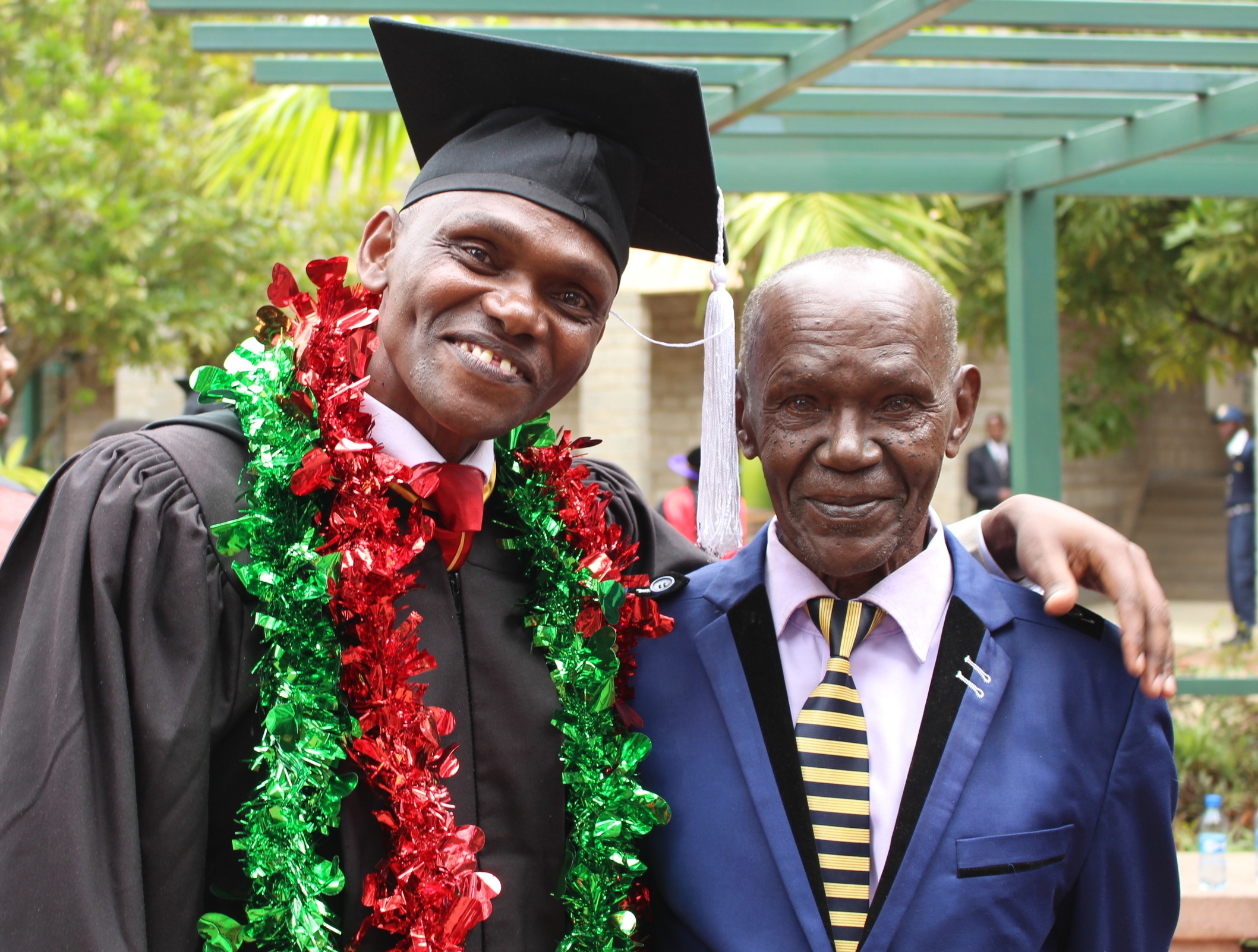 James, pictured with his father, graduated this June.
