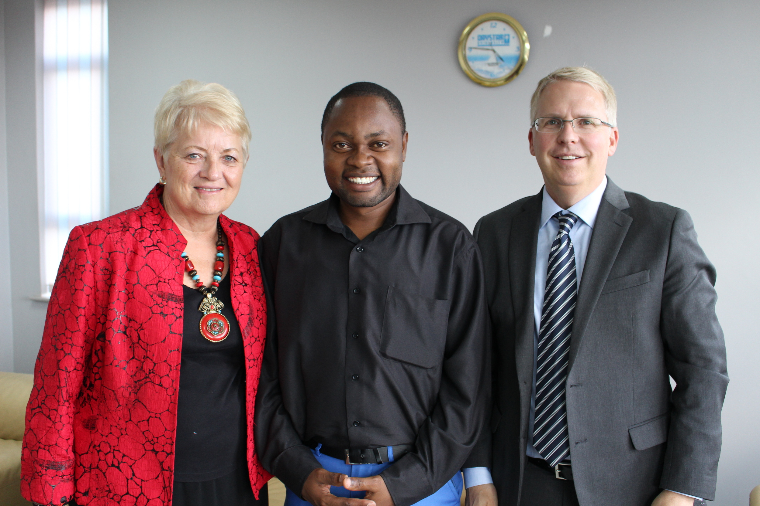 Daystar U.S. Executive Director, Kathleen Johnson, and Jon Halverson, Daystar U.S. Vice Board Chair, with Victor, a student supported by Daystar U.S.