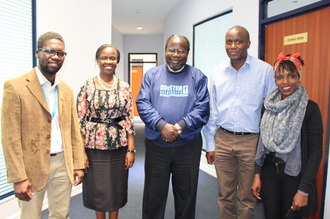 The Deputy Vice Chancellor of Academic Affairs, Dr. James Kombo, stands with the two beneficiary students, together with their sponsors, the Class of 1996, represented by Ms. Catherine Butaki (second left) and Mr. George Menge (second right).