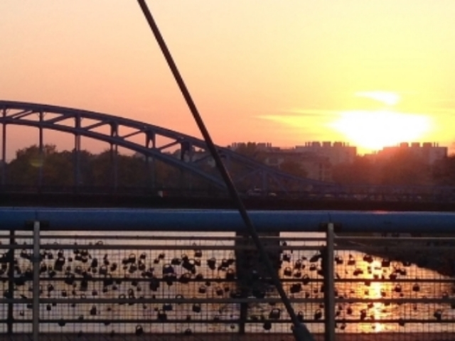 Kraków Poland_sunset Vistula river with key locks as sign of love on bridge .JPG