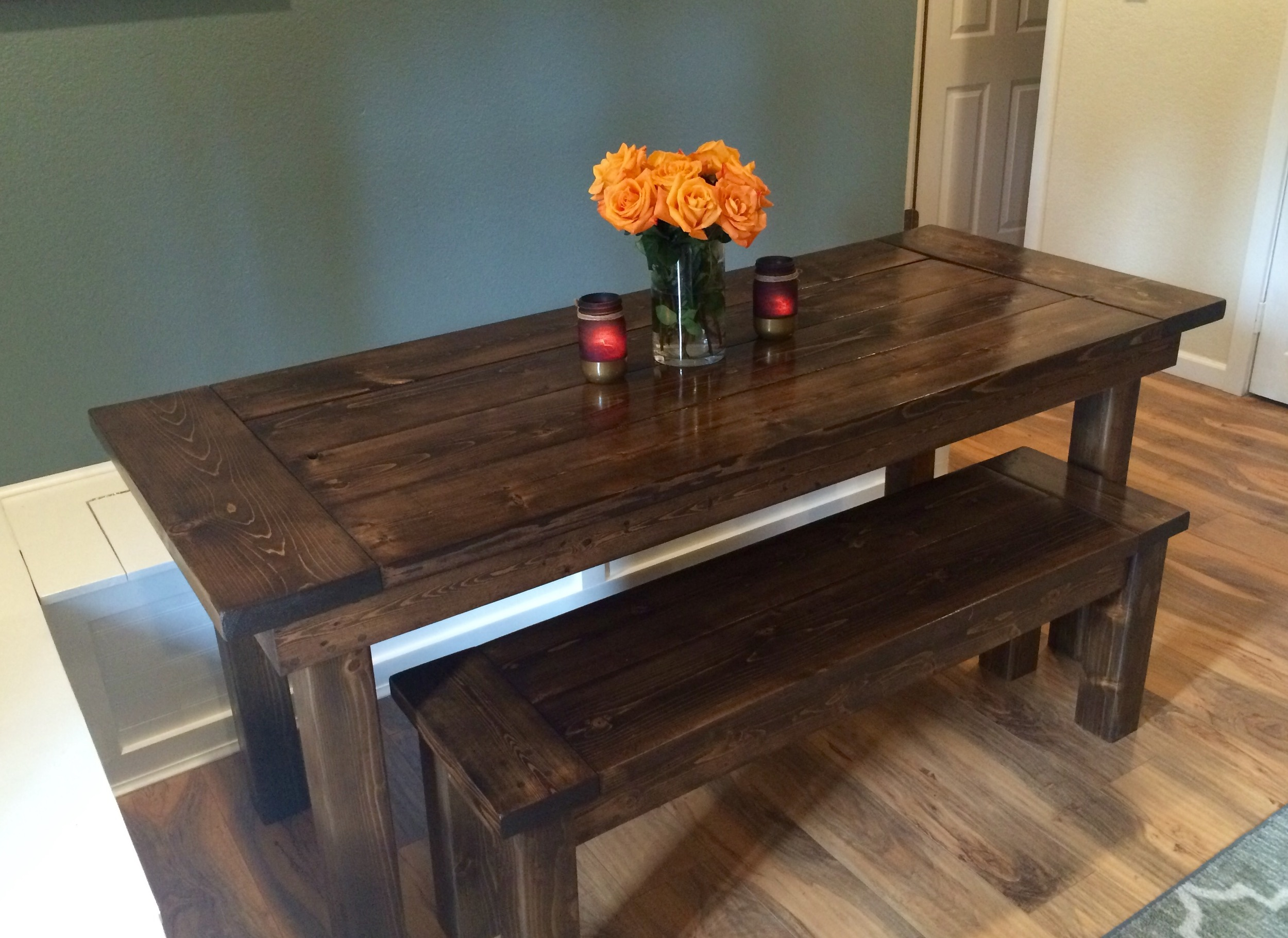6 Foot long, Farmhouse table with breadboard ends and matching bench. This stain was specially created for the client.
