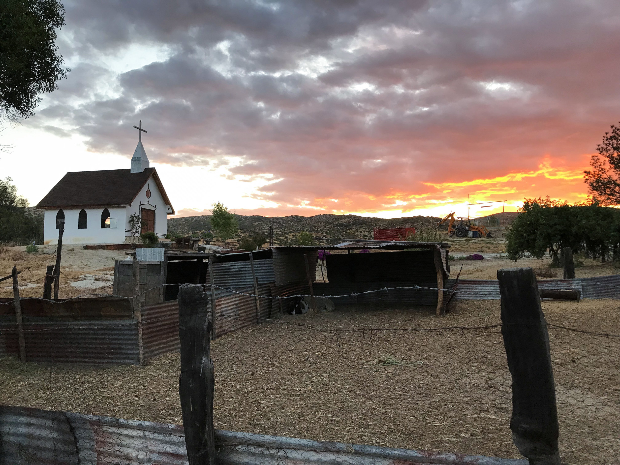 Meling Ranch at sunset. There is a pool, cabins, playground, and they even have their own church. Little bit of heaven.