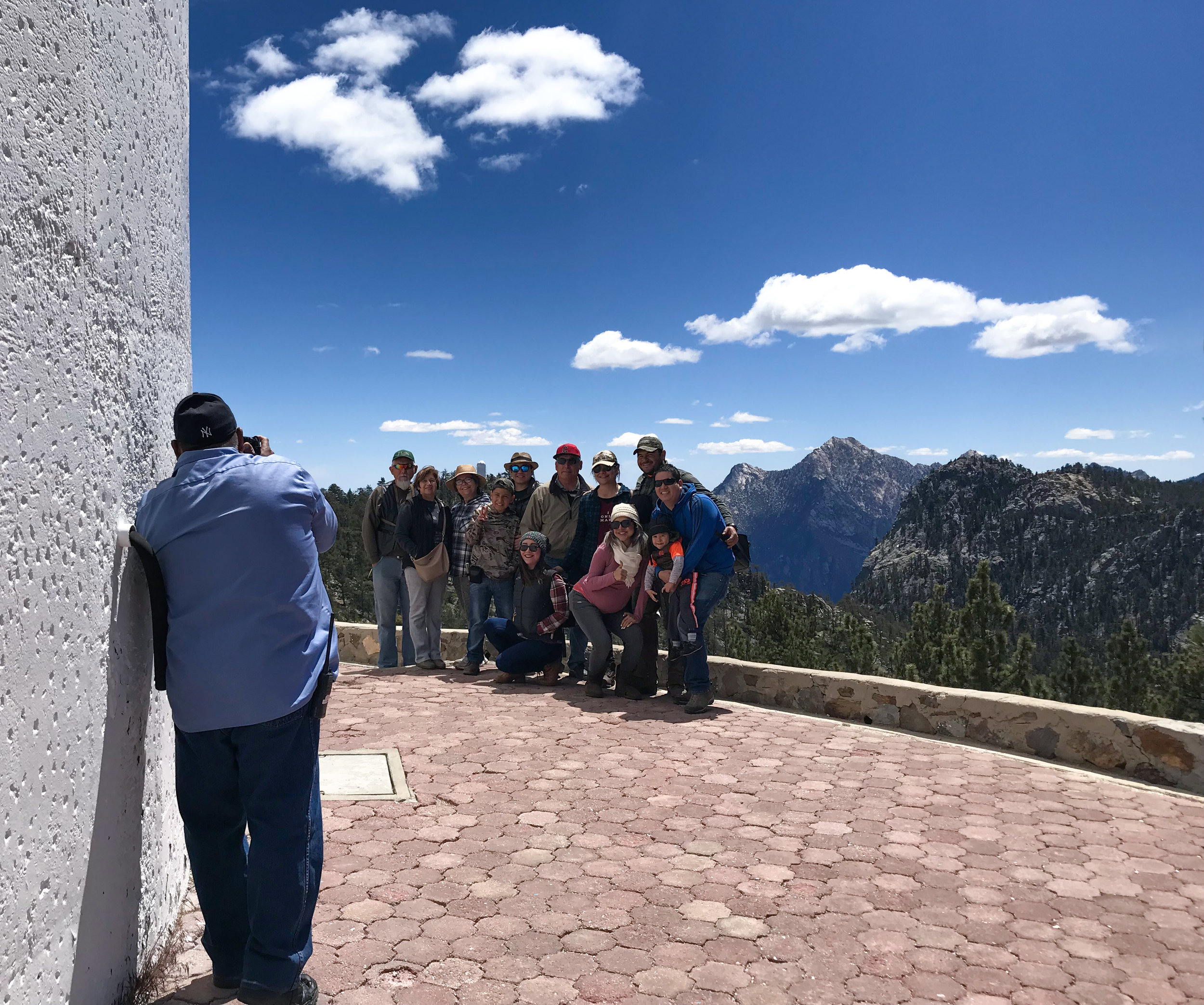 Our tour guide taking a family photo of a group. What a view!