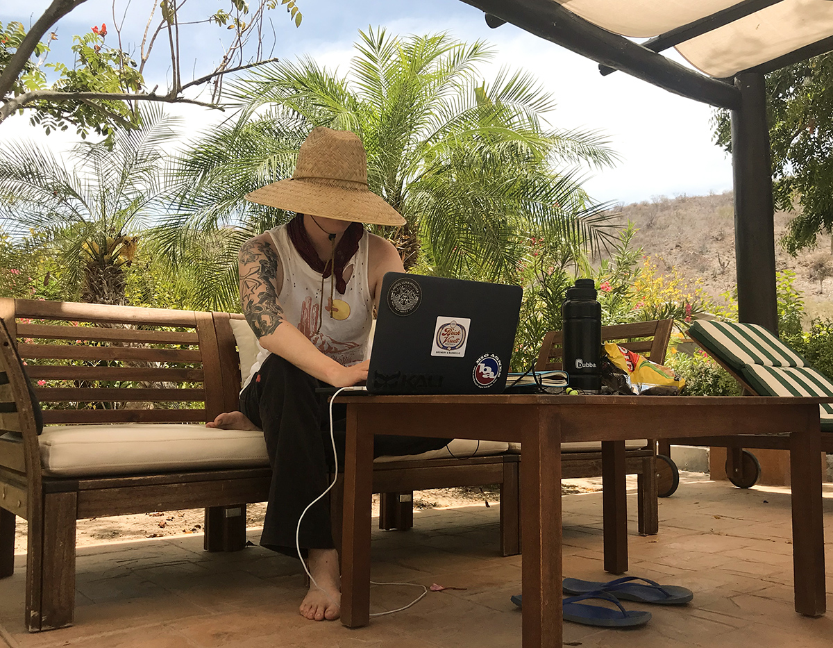 Working hard for the money, en en en en, Baja style by the pool sporting a sombrero and yes, a cut off shirt.