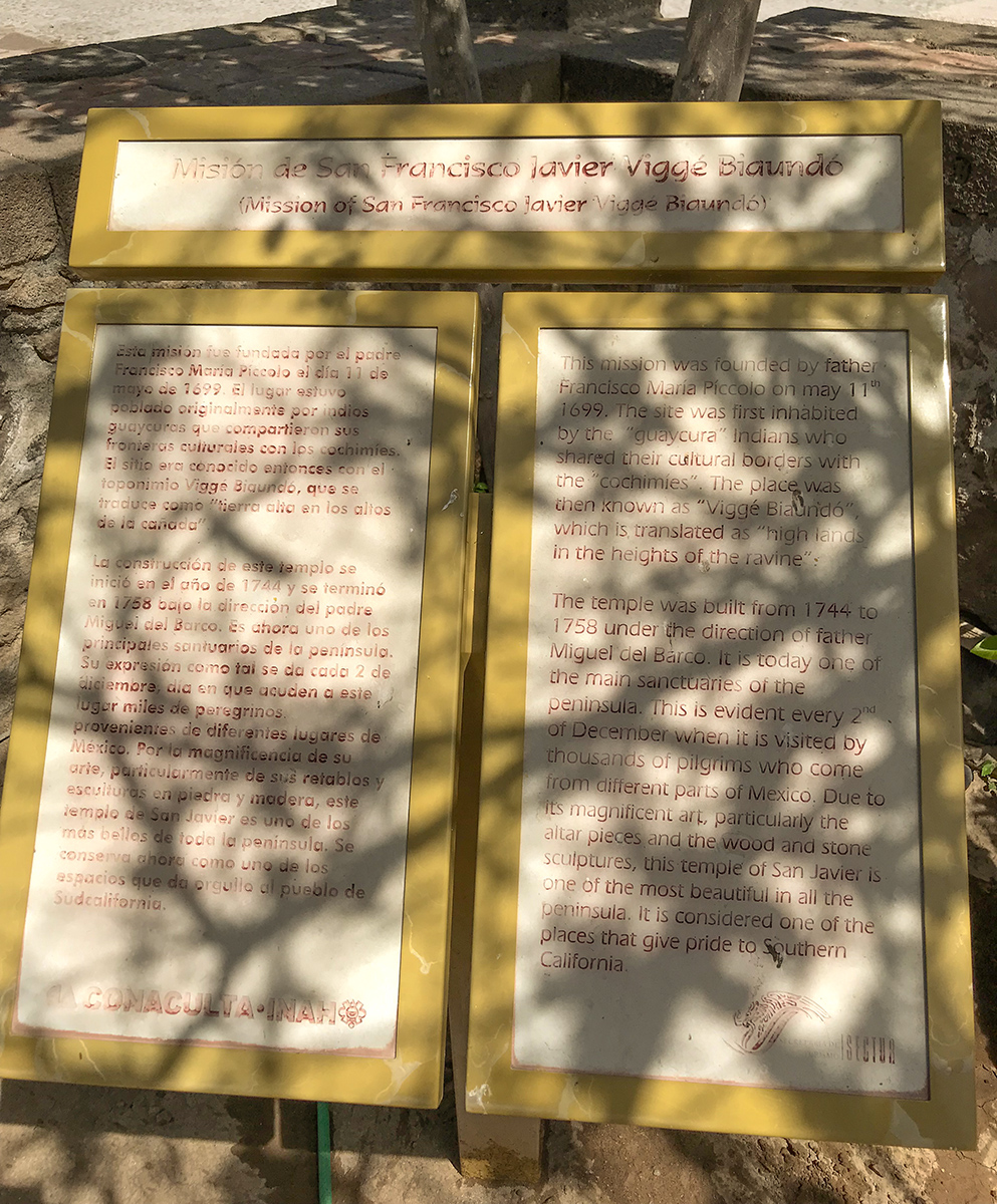 Plaque outside the mission with historic details of San Javier Mission.