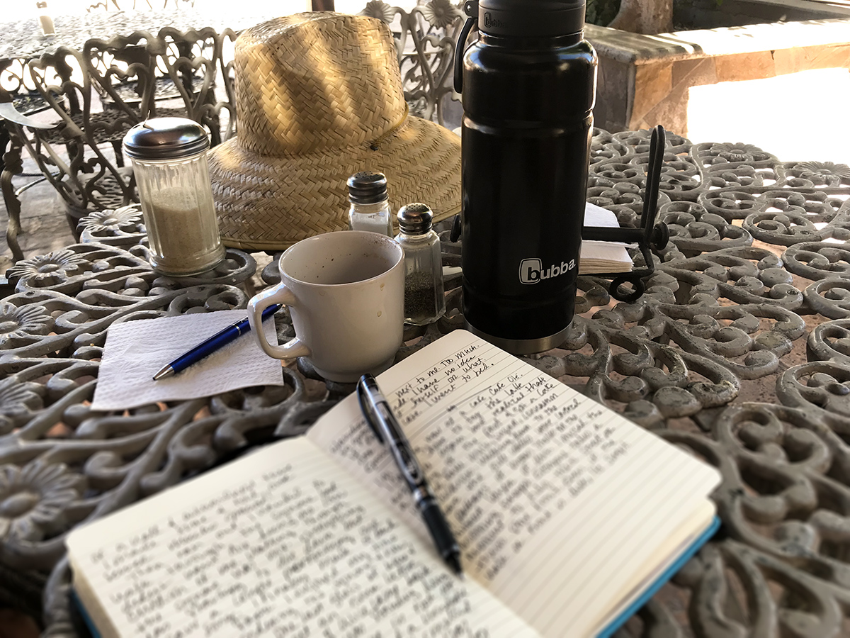 Journaling while enjoying my cafe, the sites, and the city!