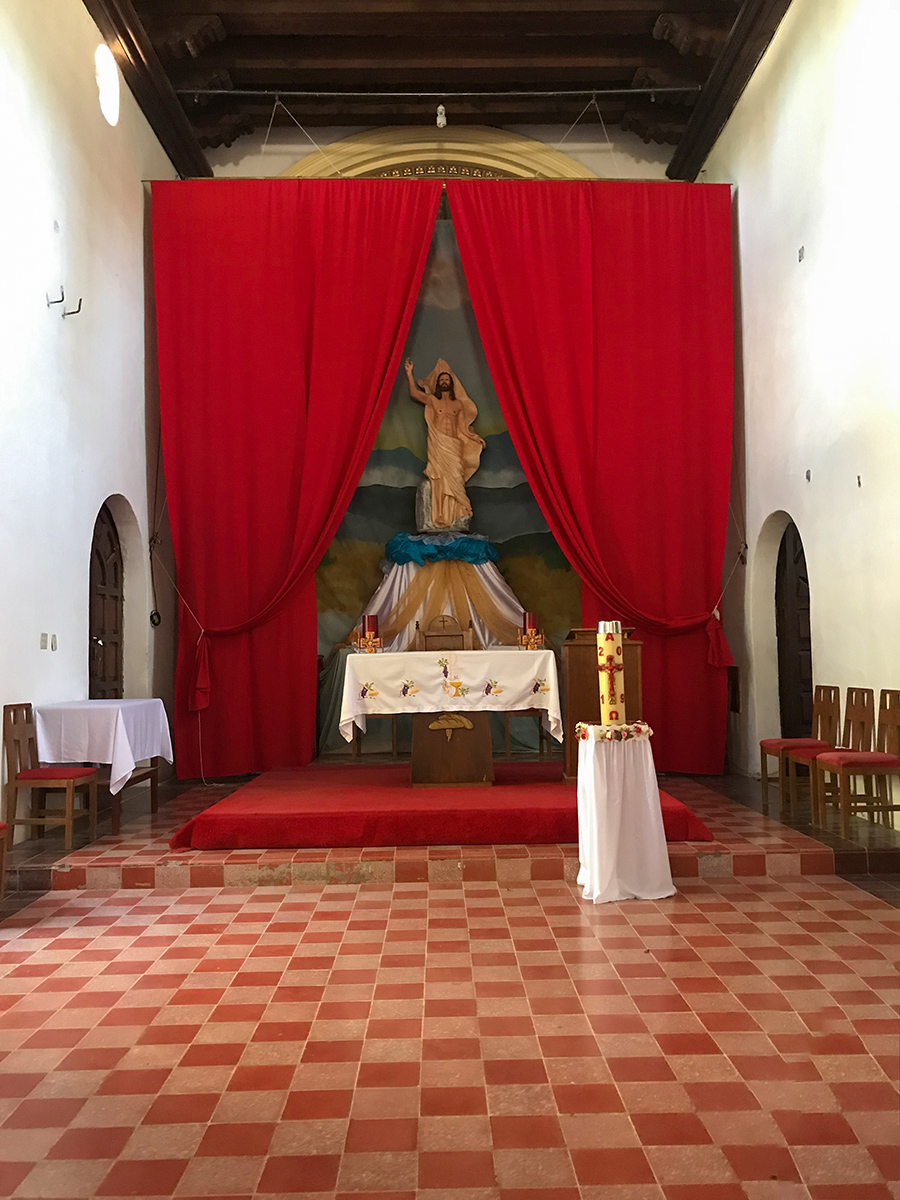 Alter of the Loreto Mission with the man behind the curtain.