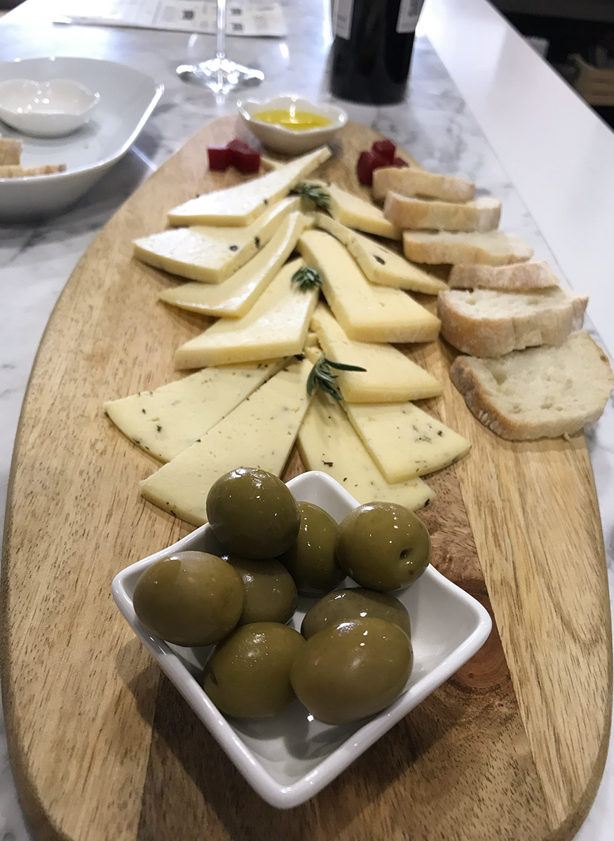 Cheese plate with local cheese, olives, and their very own olive oil at Magoni.