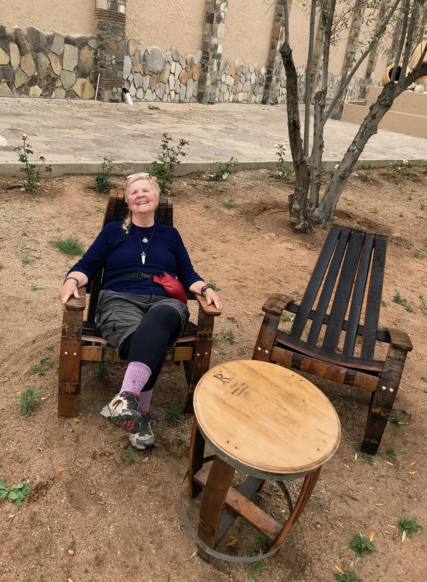 Alice enjoying the barrel chairs and table during our jaunt throughout Baja wine country.