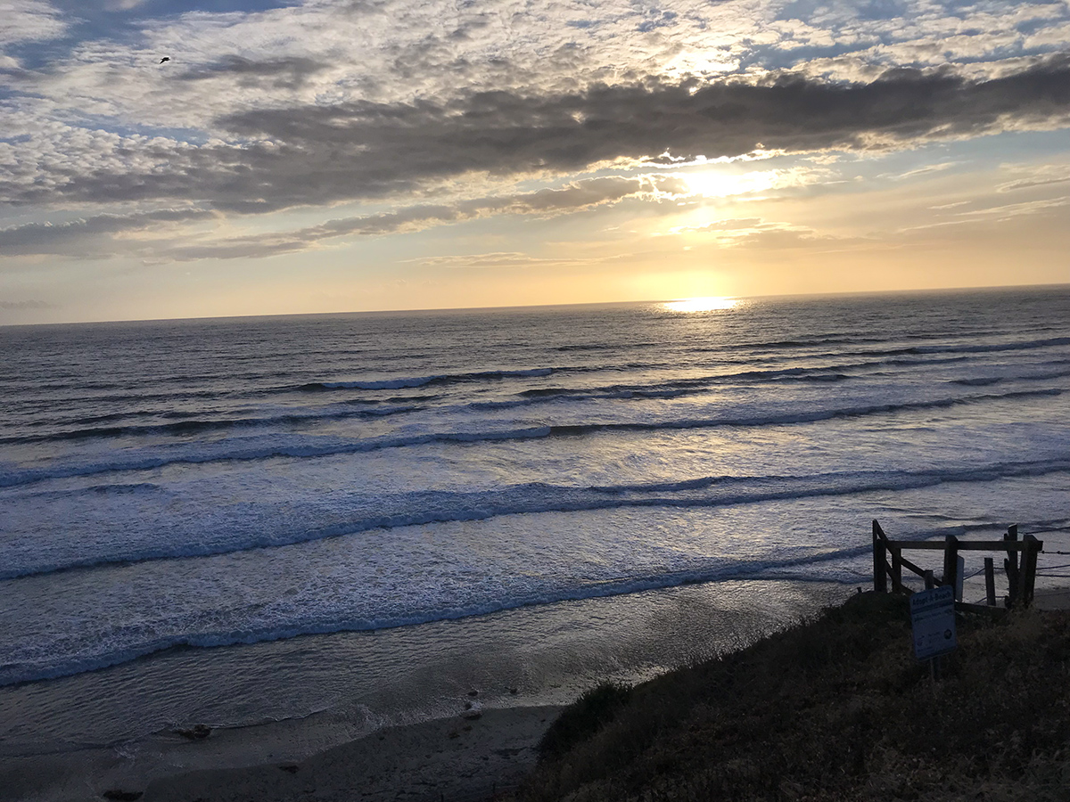 We walk to the sunset on the Pacific in Leucadia, California.