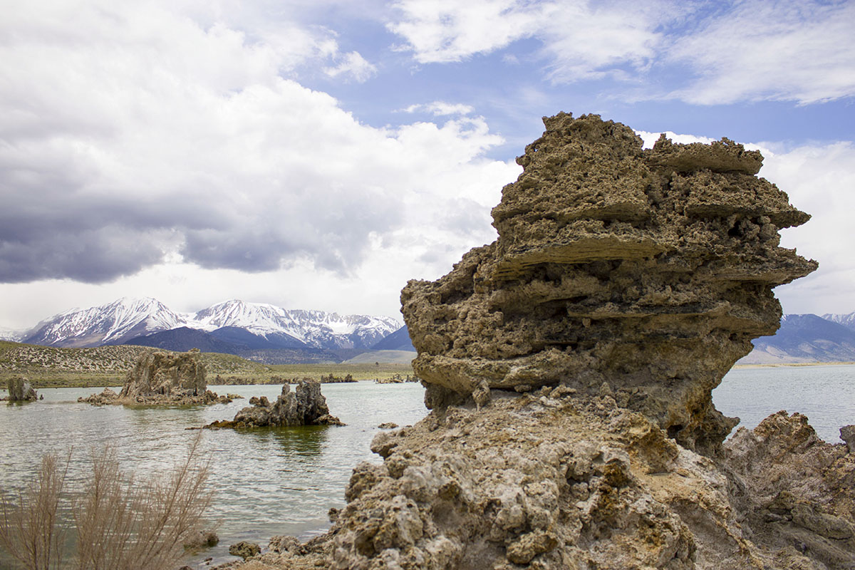 Tufa on the lake with the Sierra's in the background along with rain.
