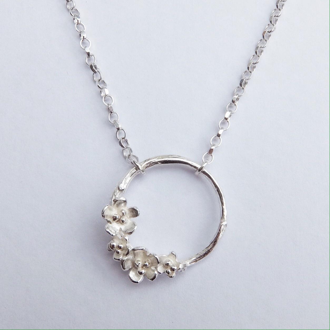 flower and twig circle silver pendant handmade uk devon jeweller jasmine bowden apple blossom necklace.jpg