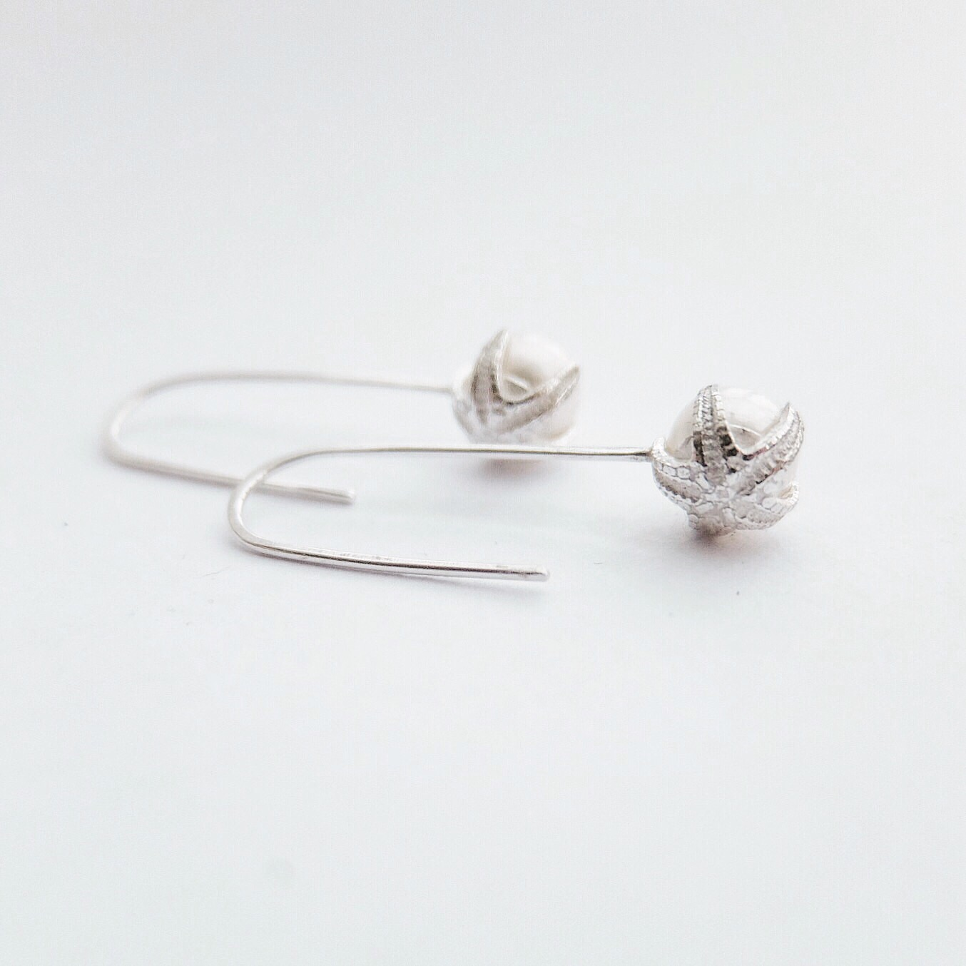 drop dangly contemporary freshwater pearl silver starfish earrings bespoke uk handmade earrings silver designer beach bridal jewellery pearls earrings wedding jewellery bride gifts white pearl simple jewelry made in devon uk exeter jasmine bowden.jpg