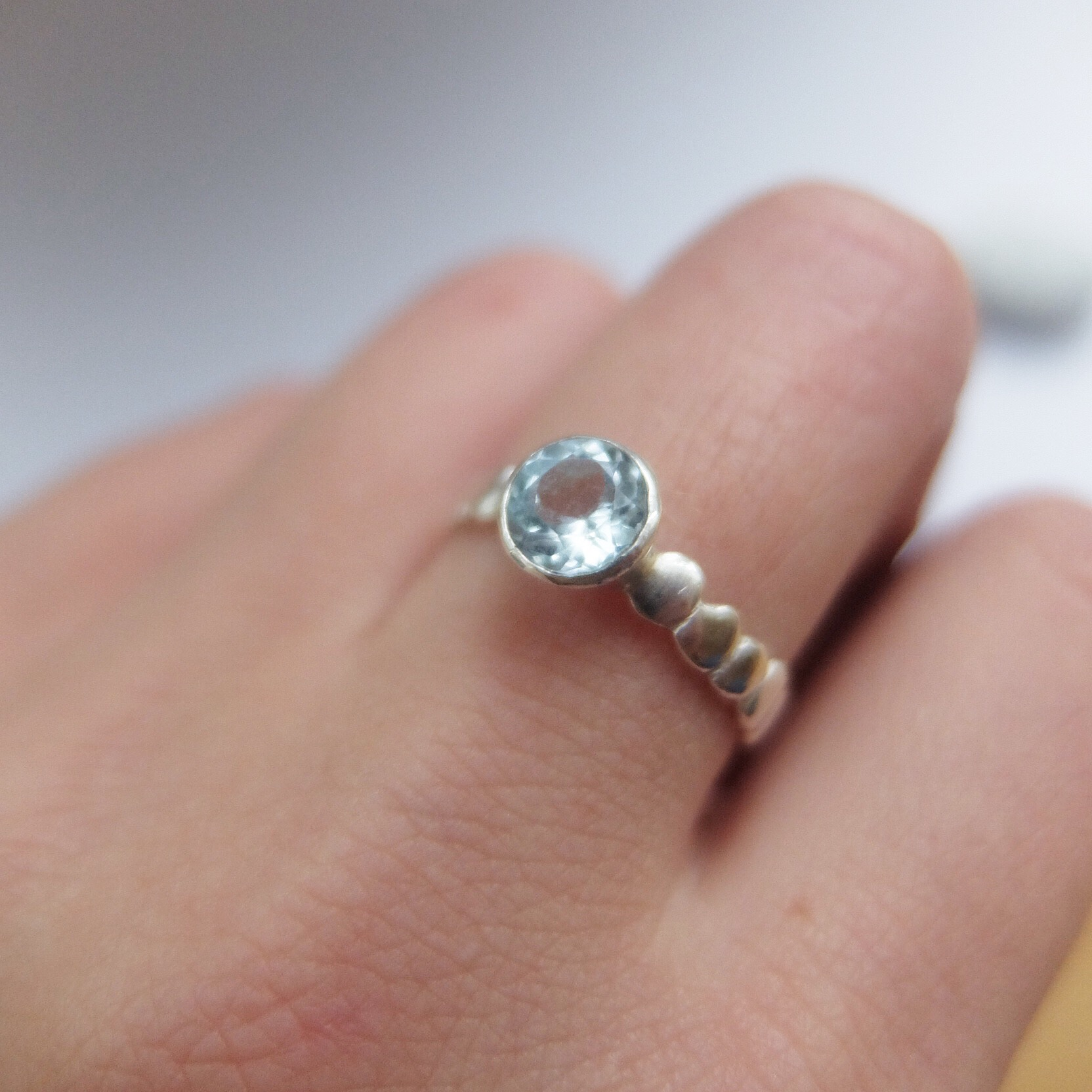 Alternative contemporary engagement rings pebble pebbles band sea inspired coast surfer blue stone gemstone handmade contemporary craft jewellery rings ring jasmine bowden uk devon cornwall round .jpg