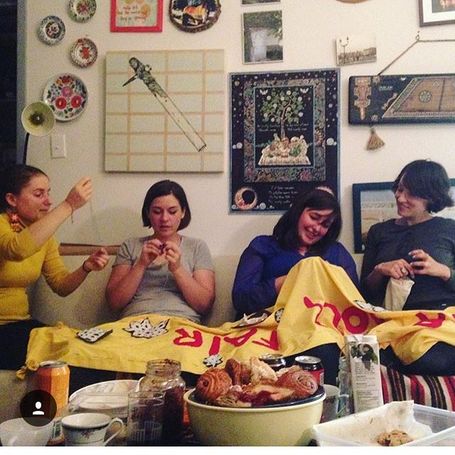 - Kosa gals getting the banner ready for our annual Winter Folk Fair, in our Toronto studio.