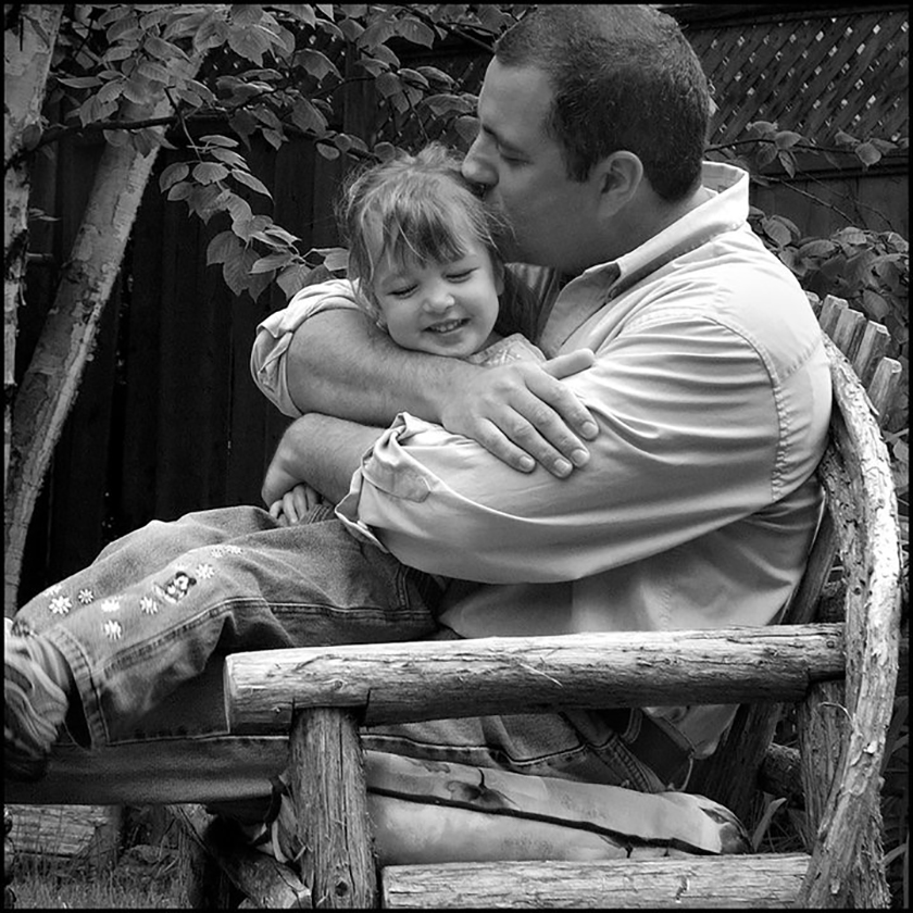 Me being a Dad, This photo hangs in my Studio... it is my favourite one even though it is over 10 years old.