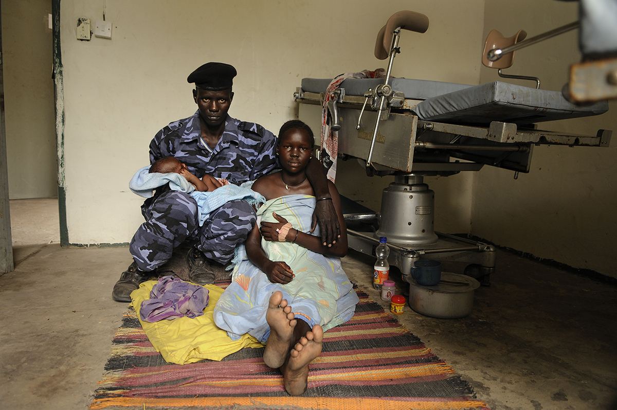 Alang Majuk Manyang, 16, right, traveled two hours to the Duk Lost Boys Clinic in Duk Payuel to give birth to her son, Akim Mathei. Her husband, Mathei Bol Atem, a police officer, holds their baby.