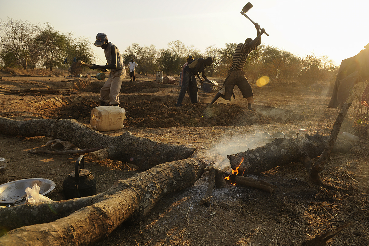 Workers in Wunlang, southern Sudan, prepare the ground to begin building the foundation for a clinic, one of several initiatives spearheaded by Village Help for South Sudan. Angelo Kiir, a former Lost Boy who was resettled in Syracuse in 2001, oversaw the project.