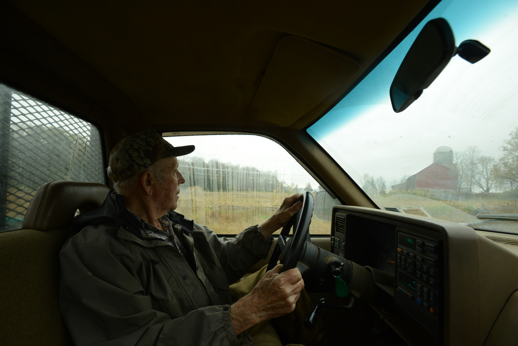 Maple syrup farmer Max Leonard, 89, of Berkshire, NY, heads back to his house for lunch after fixing lines on his maple trees. His wife of 69 years, Esther, recently died and Max moves through his grief with the help of his work.