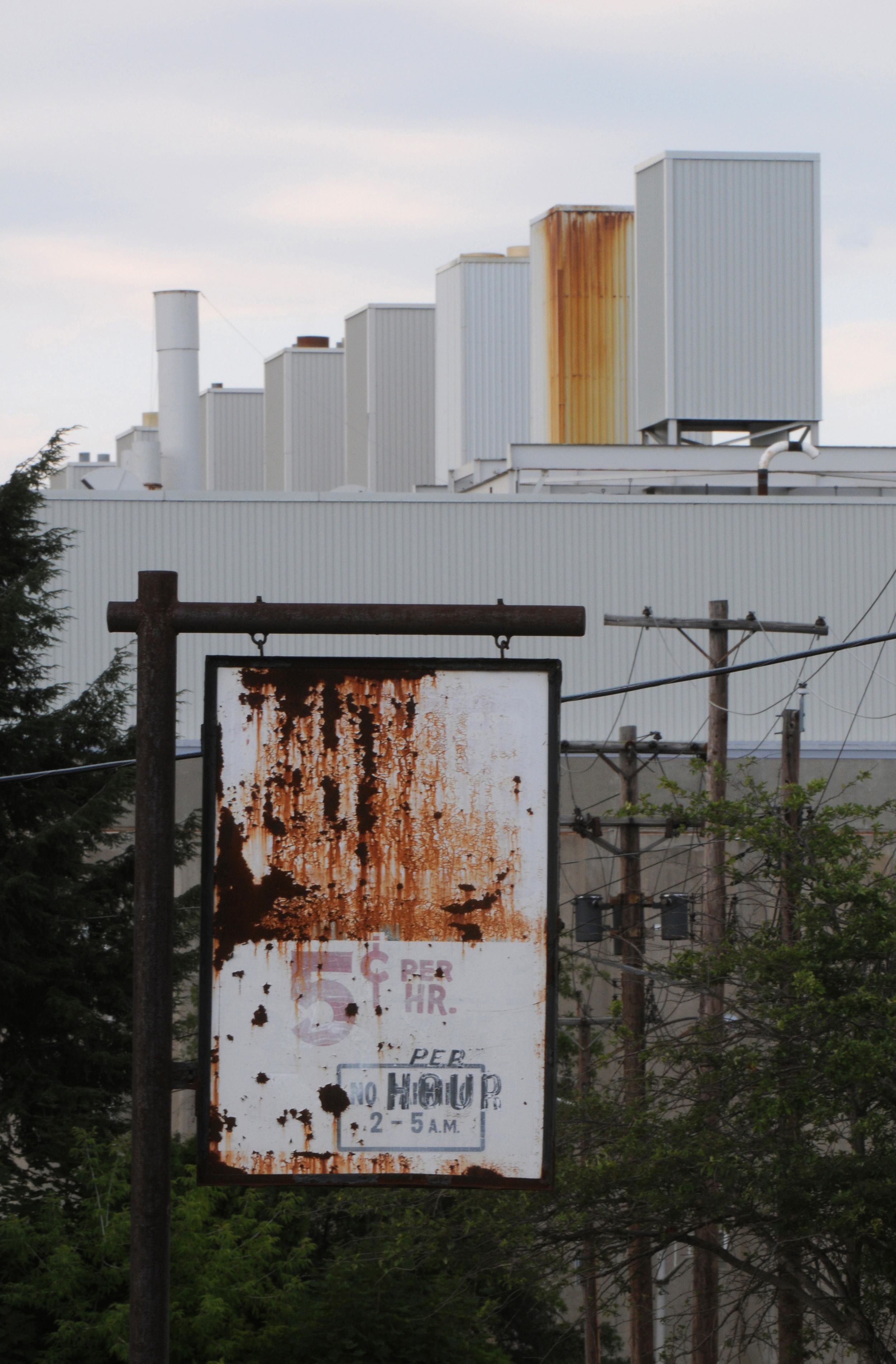 One of the most contaminated buildings on the former IBM campus, Building 18, is shown behind a parking sign dating back to more prosperous times in Endicott. Spills and leaks of toxic chemicals at the plant, including a documented 1979 leak of 4,100 gallons of TCE - a chemical used to clean computer circuit boards - left behind volatile organic compounds in the town's soil and aquifer. IBM has spent millions on clean-up.
