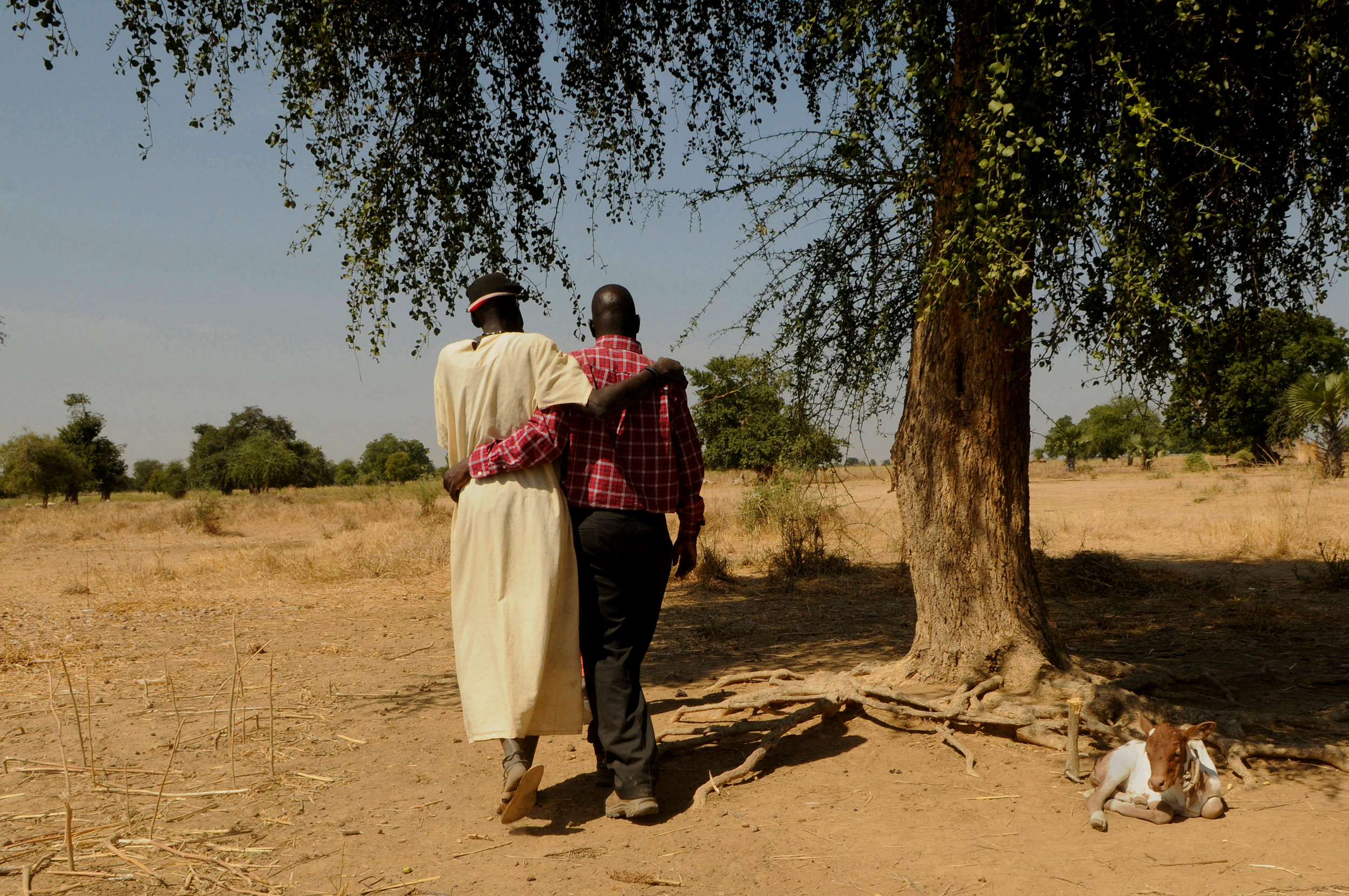 Gabriel Bol Deng, who raised money for wells and a school for his home village of Ariang, visits the tree where his mother and his placenta are buried, a Dinka tradition. Garang Deng Majok, Gabriel's uncle, performed a traditional water ceremony blessing Gabriel.