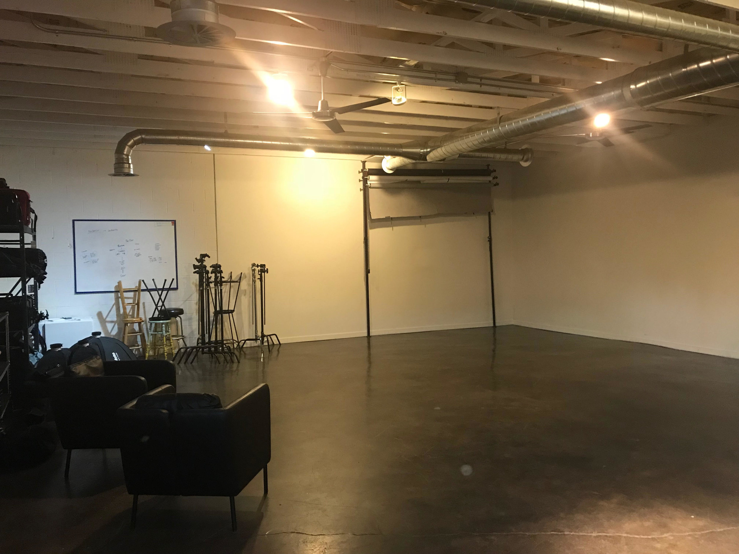The main studio space, complete with floors, walls, and comfy chairs.