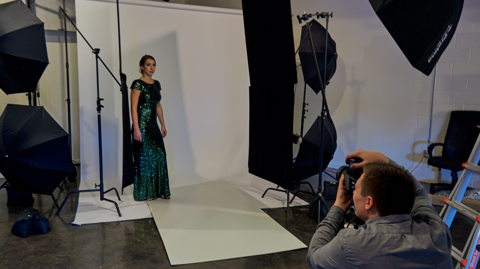 We used about 8 different lights, with soft boxes of varying sizes, as well as umbrellas, all with a white paper backdrop.