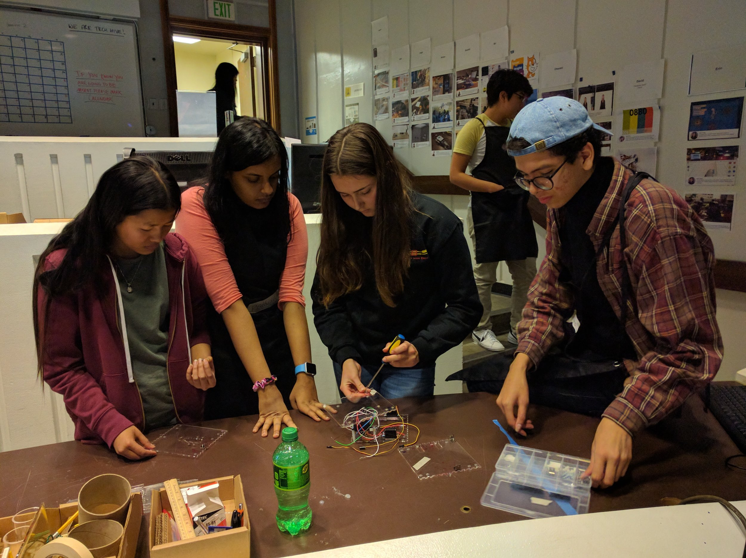 Neesha, Radhika, Roni and Leo assembling the head of their Explainer Bot.