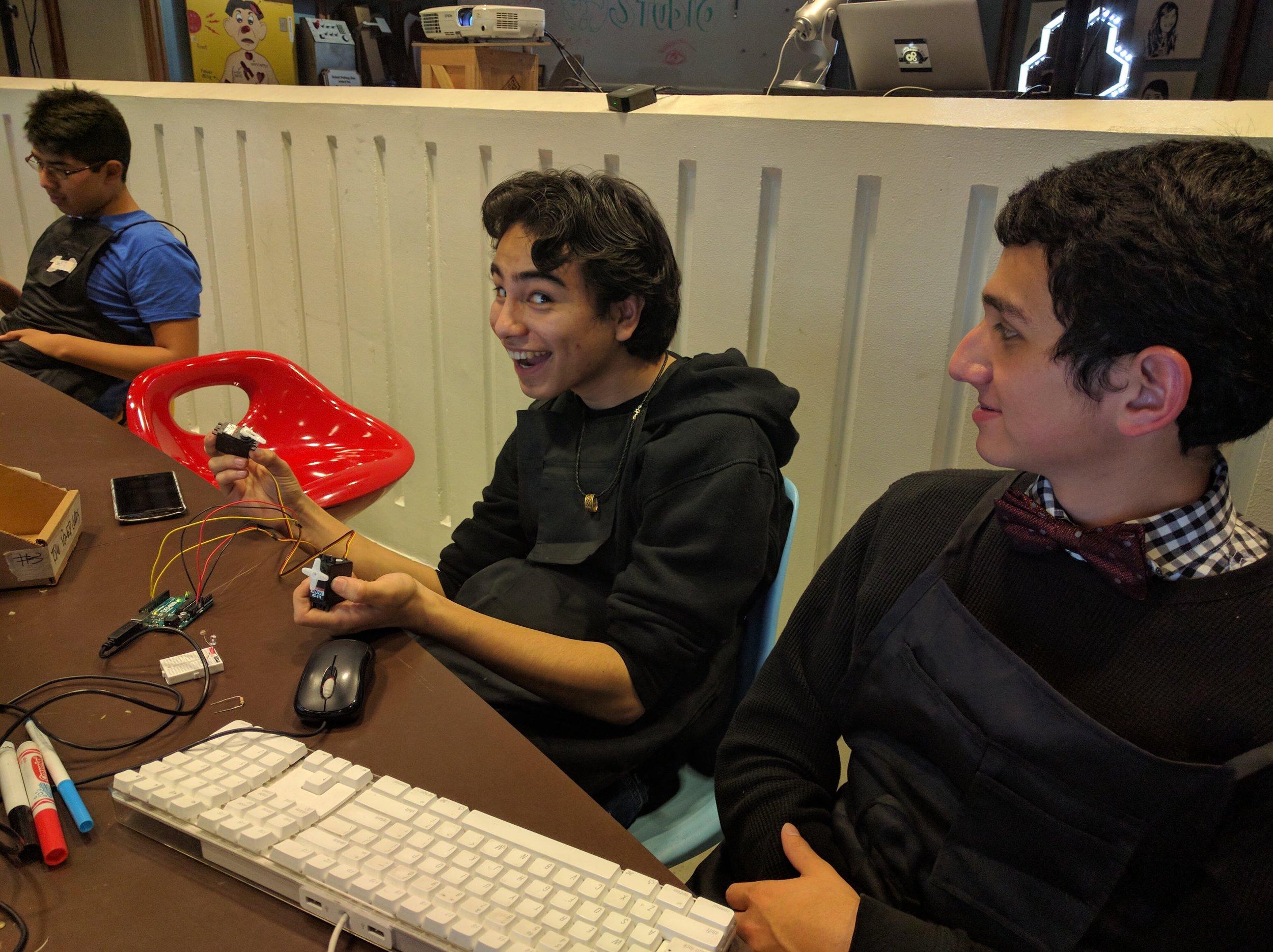 DJ and Javier troubleshooting their servos.