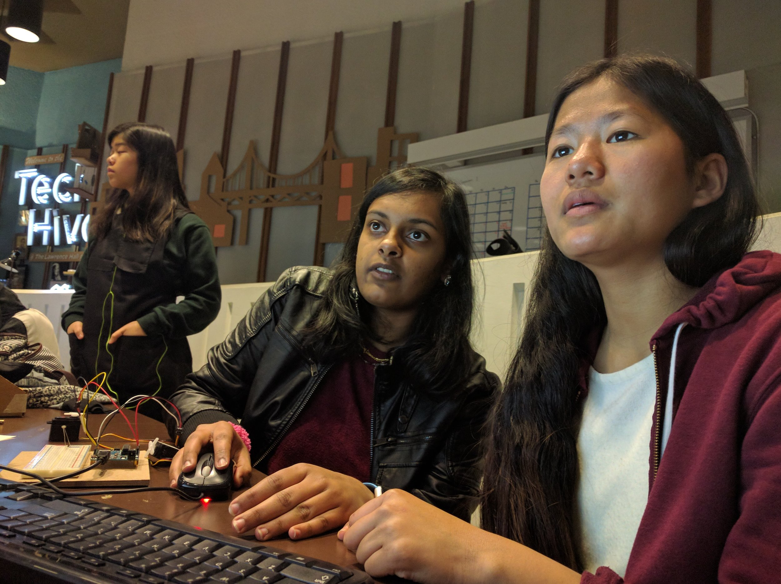 Neesha and Radhika coding away!