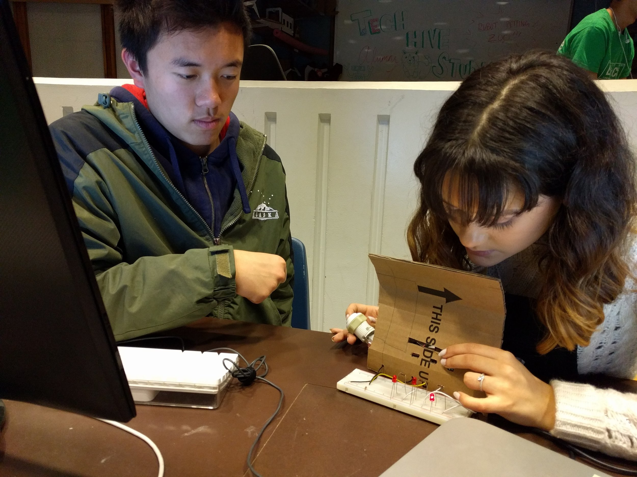 Marie and Edmond building the first iteration of their Status Prism.