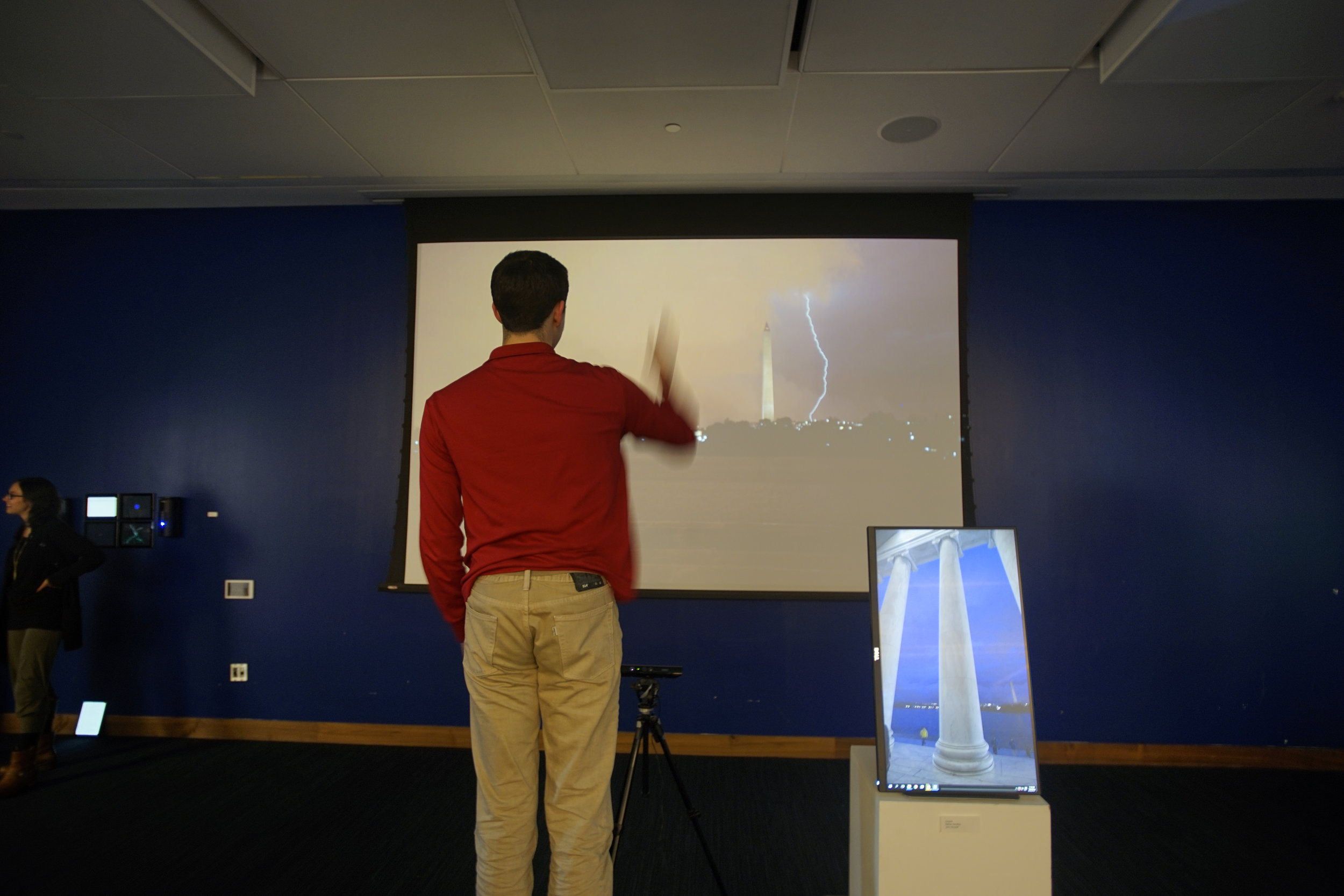 NATHAN DANSKEY - CONJURE   Interactive installation.    As participants moved their arms up and down, motion-detecting software in  Conjure  would be triggered and lightning appeared on the screen next to the Washington Monument. This was real footage of a summer D.C. storm.