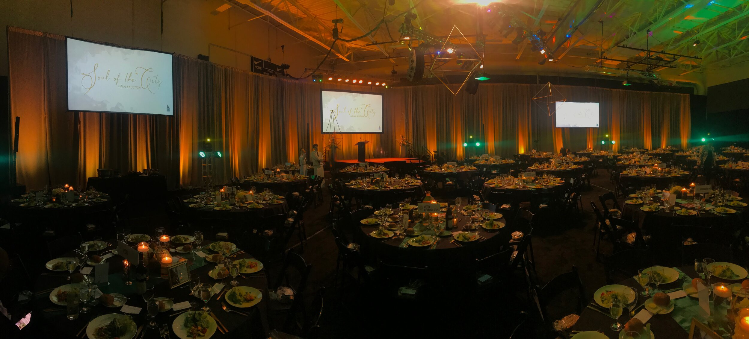 draping for fundraiser event.  black with amber uplighting.