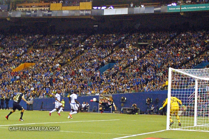 Montreal, Canada - April 29, 2015: Dario Benedetto of Club America completes a mid air volley to tie the game 1-1 in the 5th minute of the second half.